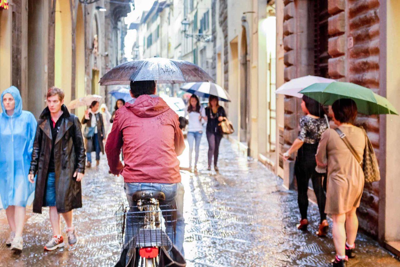 Cyclist umbrella Florence Italy