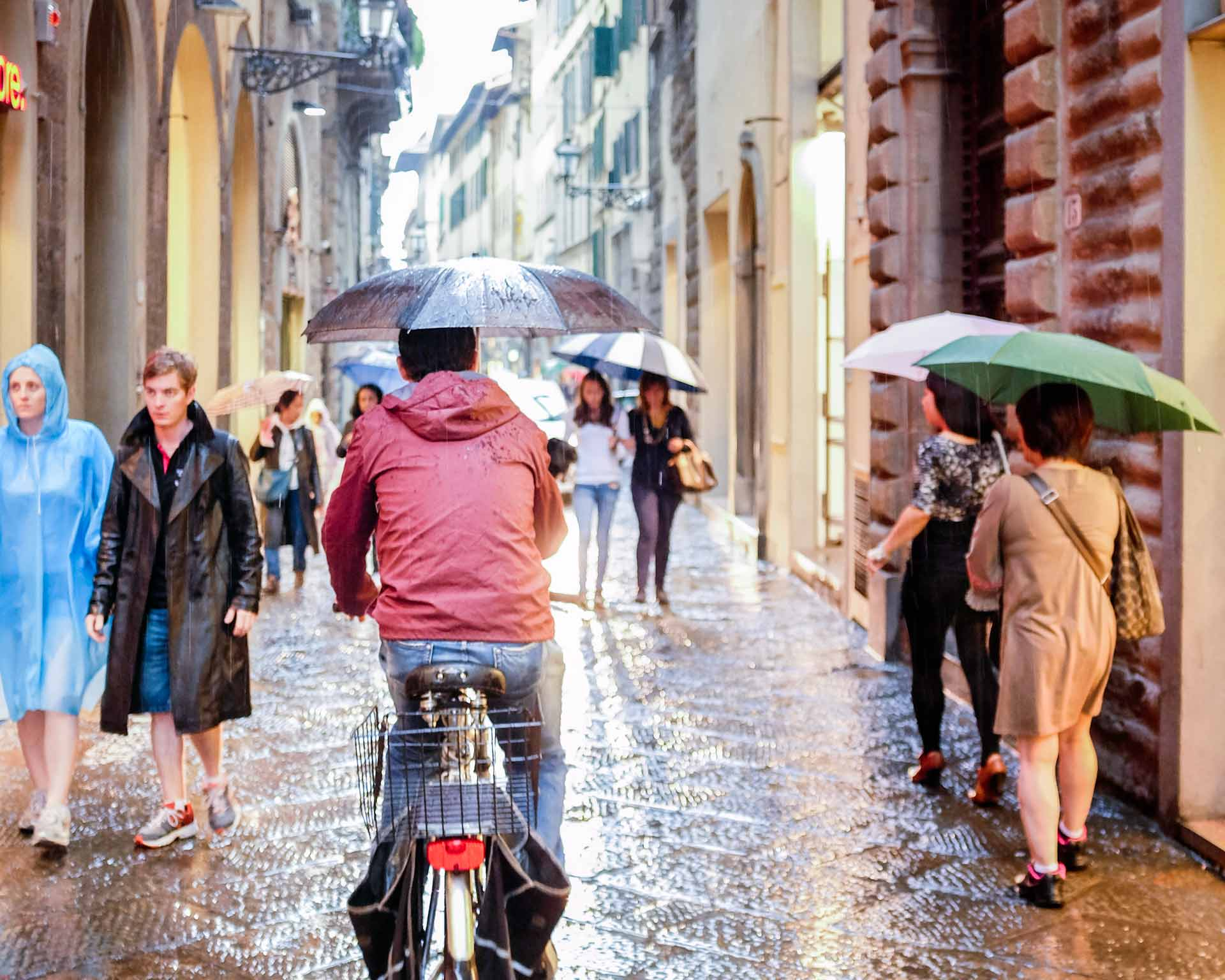 Cyclist umbrella Florence Italy